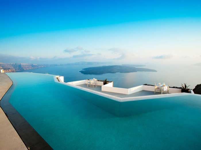 29 infinity pools that will make you want to drown in your for Hotels in santorini with infinity pools