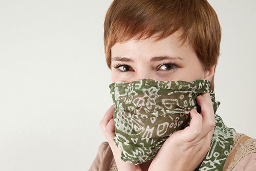woman-covering-mouth-with-a-cloth