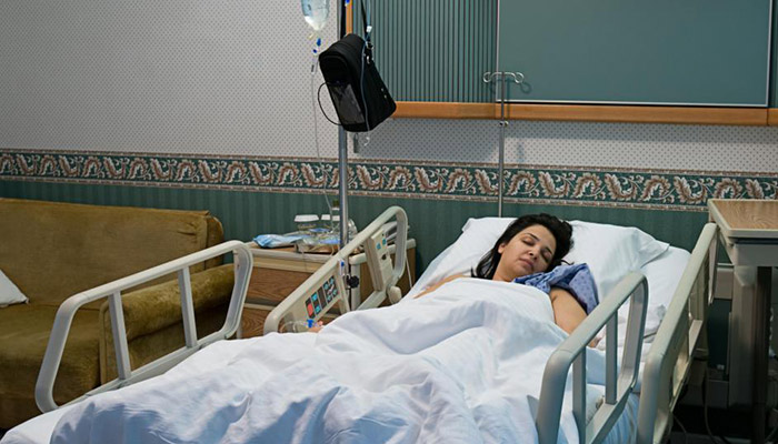 woman-resting-in-hospital-bed