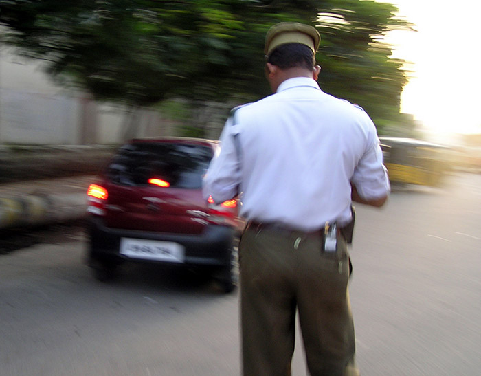 Traffic cop stops President's convoy to let ambulance pass, wins hearts & minds