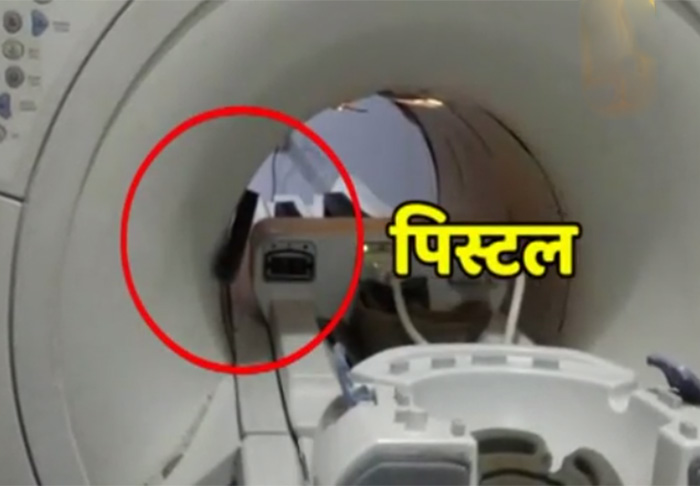 UP minister's guard carries gun during MRI scan, ruins machine