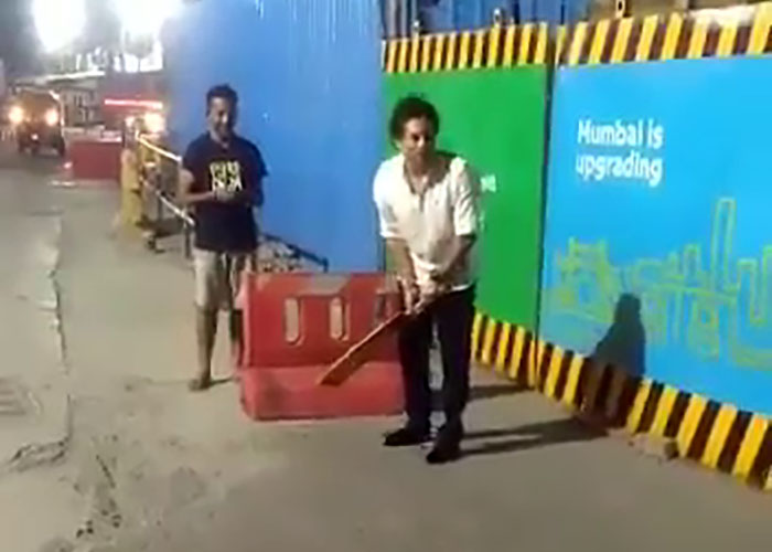 Sachin Tendulkar plays street cricket in Mumbai with local boy