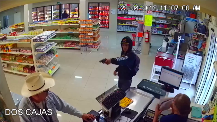 Man tackles armed robber
