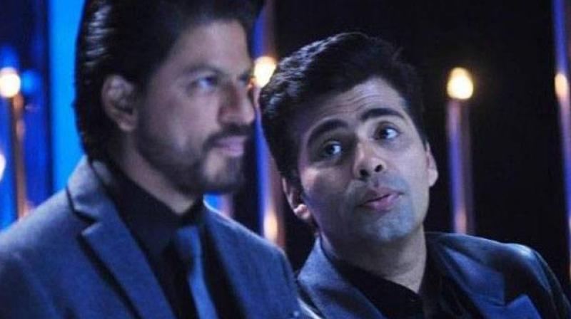 #ShameOnKaranJohar: Ace director slammed for liking anti-SRK tweet