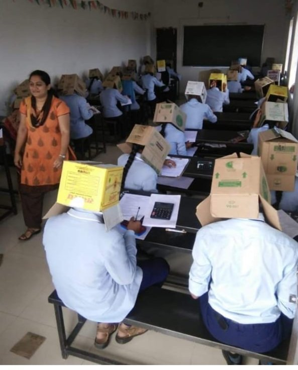 Indian students wear boxes on their heads during exam to prevent cheating